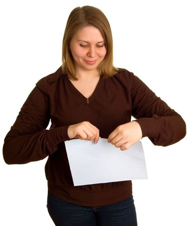 insult: The young smiling women breaks off a paper. Isolation on a white background Stock Photo