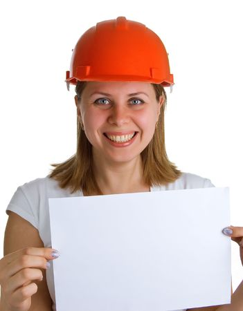 The young smiling women in a red building helmet holding a sheet of paper in a hand. Isolation on a white background Stock Photo - 4750468