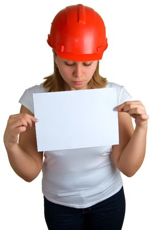 The young women in a red building helmet holding a sheet of paper in a hand. Isolation on a white background Stock Photo - 4771661