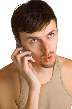 Portrait of the young surprised men with cellular phone on a white background. Isolation photo