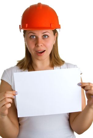 Surprised young women in a red building helmet with a sheet of paper in a hand. Isolation on a white background Stock Photo - 4834909