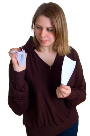 insult: The young women breaks off a paper. Isolation on a white background