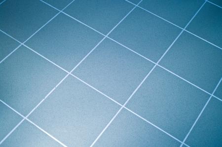 Ceramic tile floor blue color. Shallow DOF Stock Photo - 4981239