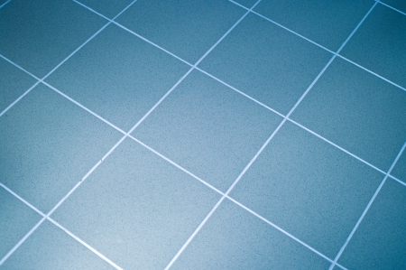 Ceramic tile floor blue color. Shallow DOF Stock Photo