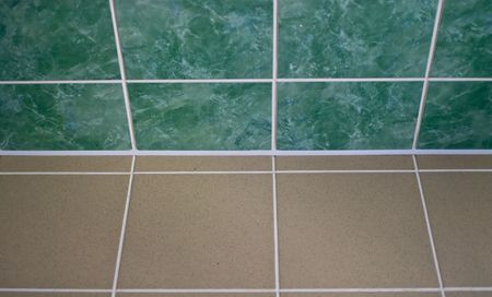 Ceramic tile floor brown and green color. Shallow DOF photo