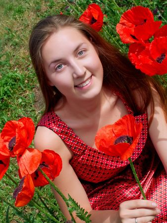 Young girl with long hair in poppies field