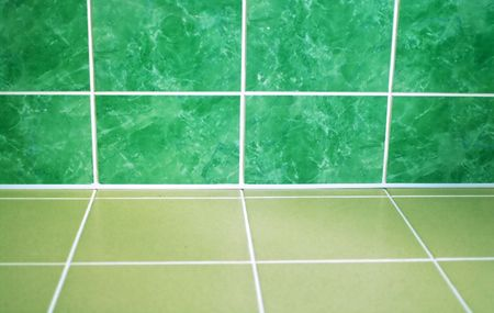 Ceramic tile floor of green color. Shallow DOF photo