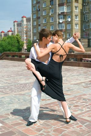 young couple dancing Latino dance against urban landscape Stock Photo - 5116683