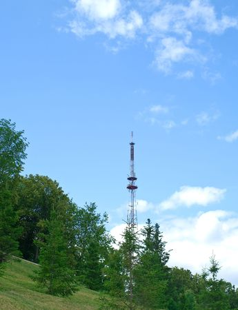 Telecommunication mast against summer landscape. Ufa city, Bashkortostan, Russia Stock Photo