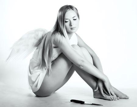 attractive angels: lovely angel with a knife on white background