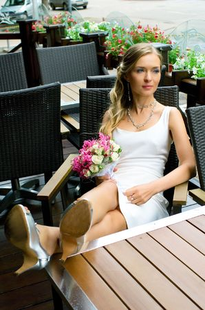 Bride on terrace of restaurant. Shallow DOF Stock Photo - 5361986