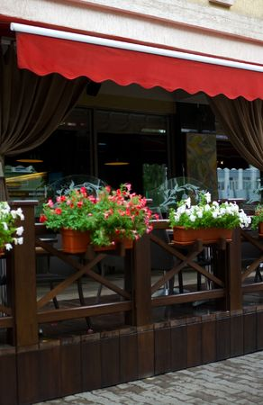 Outside terrace of restaurant with floral lawns. Shallow DOF Stock Photo - 5376206