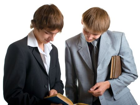 Two young happy students reading the books. Isolation on white background