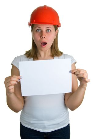 Surprised young women in a red building helmet with a sheet of paper in a hand. Isolation on a white background