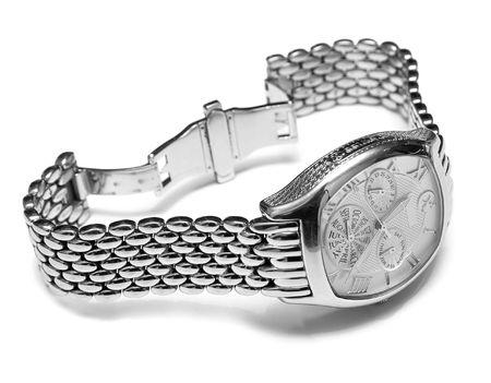 mans watch: Reloj de hombre de la Plata. Aislamiento sobre un fondo blanco. Macro. DOF superficial  Foto de archivo