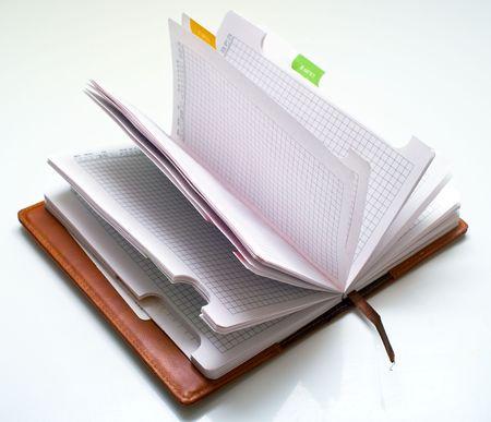 Opened notepad on white background Stock Photo - 5993606