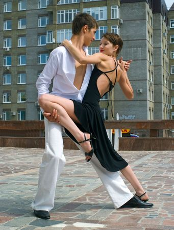 young couple dancing Latino dance against urban landscape Stock Photo - 6023196