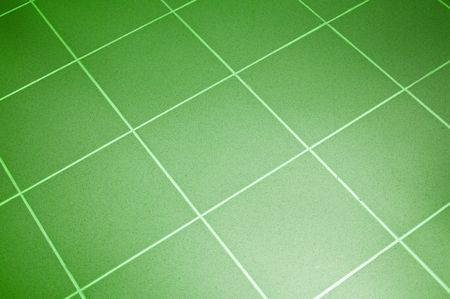 Ceramic tile floor green color. Shallow DOF