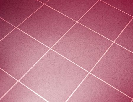 Ceramic tile floor red color. Shallow DOF photo