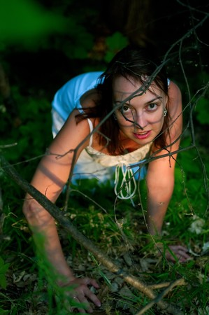 the thicket: The young woman in a white dress in a thicket