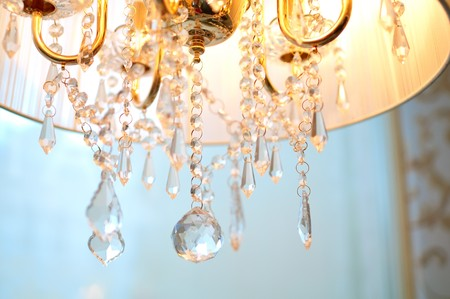 Old style chandelier on light background. Shallow DOF Stock Photo