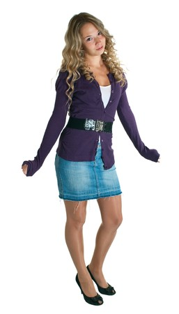 skirt: The young beautiful girl in a lilac shirt and jeans skirt. Isolation on a white background