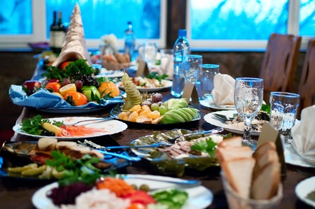 Food on the table. Interior of modern restaurant. Shallow DOF Stock Photo