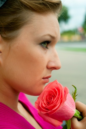 Portrait of the beautiful girl with pink rose. Shallow DOF Stock Photo - 9194625