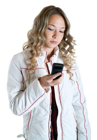 beautiful serenity girl in white jacket with cellular phone on a white background. Isolation  photo