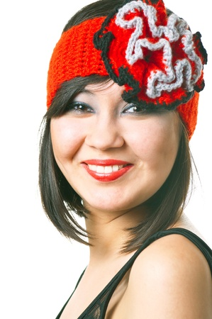 womanliness: Portrait of smiling stylish woman in the retro hat with bright red lips. Shallow DOF