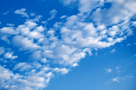 The blue sky background with white clouds