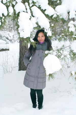 Attractive young girl in wintertime outdoor