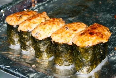 Many hot sushi rolls. Shallow DOF Stock Photo