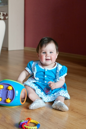 The little girl with toy at home. Shallow DOF Stock Photo