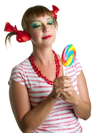 Fun smiling girl with candy on white background. Isolation. Stock Photo