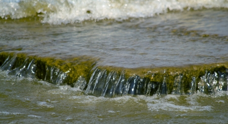 Waves of river and rocks. The natural background, shallow DOF Stock Photo