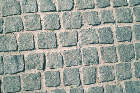 The stones on sidewalk. A background. Shallow DOF