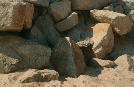 A pile of beige stones in a shore of a beach