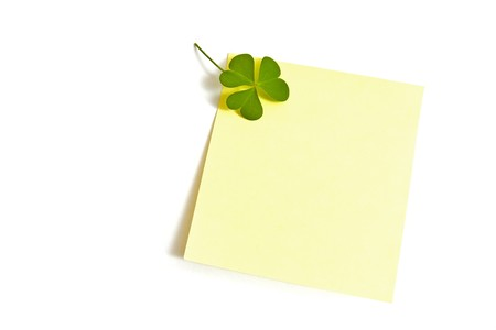 A yellow post-it with a lucky clover, isolated on white. Perfect for use in Luck and St. Patrick's Day themes. Stock Photo - 4368734