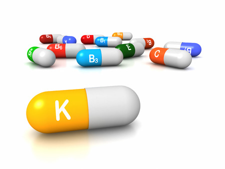 High resolution 3D render of vitamin supplements, focus on Vitamin K Phylloquinone Stock Photo