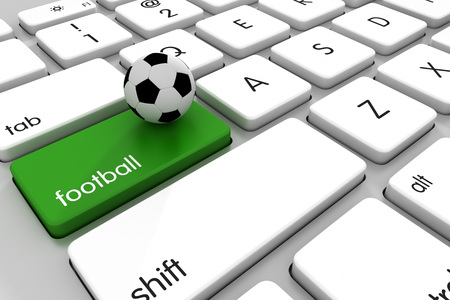 betting: Three dimensional render of a soccer ball on a modern keyboard. Concept for sports betting. Stock Photo