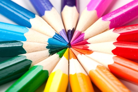 office stationery: color pencils on white background