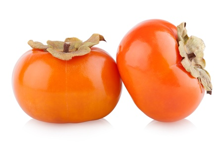 ripe persimmons isolated on white