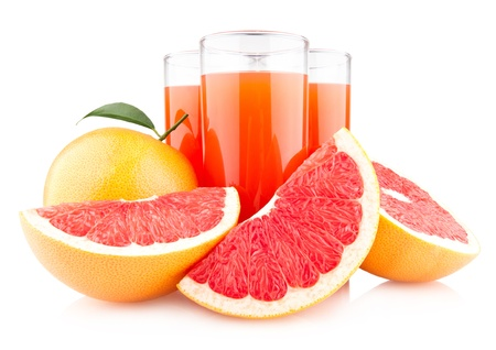 grapefruit juice with ripe grapefruits photo