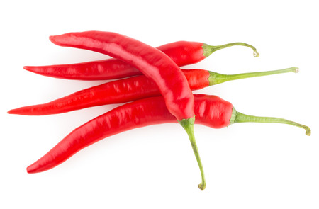 cayenne: red chili peppers isolated on white background