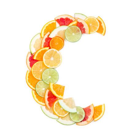 c vitamin: Vitamin C concept (letter C made of citrus slices)