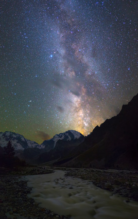 dark clouds: Milky Way over mountains