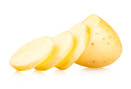 sliced: sliced potato isolated on white background