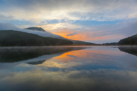 fog forest: Evening at mountain lake Stock Photo