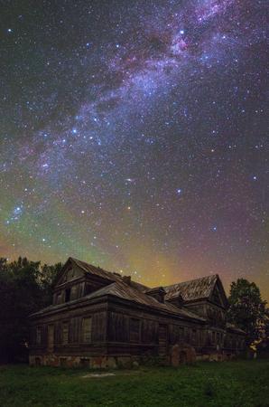 dark skies: Old house under stars